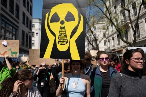 """Students take part in a """"Youth For Climate"""" demonstration, urging pupils to skip classes to protest against a lack of climate awareness, on April 12, 2019, in Lyon France"""