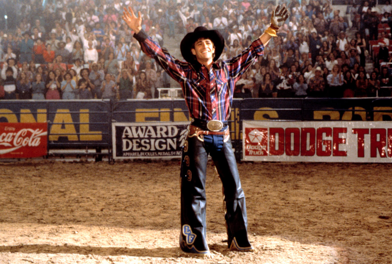 <p>Oscar-winning <i>Rocky</i> director John G. Avildsen directed Perry in this story of bull rider Lane Frost, who died tragically at 25, when a bull rammed him after he competed at a Wyoming rodeo in 1989. (Photo: Everett Collection) </p>