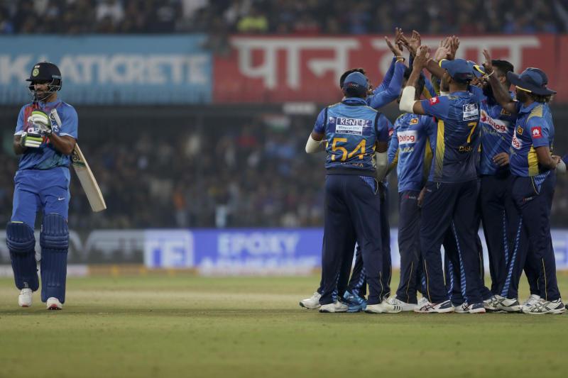 Sri Lankan players celebrate the dismissal of India's Shikhar Dhawan, left, during the second Twenty20 international cricket match between India and Sri Lanka in Indore, India, Tuesday, Jan. 7, 2020. (AP Photo/Aijaz Rahi)