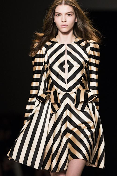 A model walks the runway at the presentation of the Jill Stuart Fall 2013 fashion collection during Fashion Week, Saturday, Feb. 9, 2013, in New York. (AP Photo/John Minchillo)