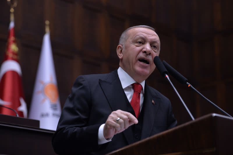 Turkish President Erdogan addresses members of his ruling AK Party at the parliament in Ankara