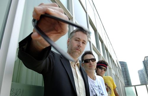 In this July 26, 2006 photo, Beastie Boys Adam 'MCA' Yauch, left, Adam Horovitz (Adrock), centre, and Mike Diamond (Mike D) pose for a photograph in Toronto. (AP Photo/The Canadian Press, Aaron Harris)