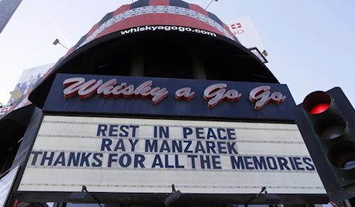 The Whisky a Go Go's marquee honors musician Ray Manzarek of The Doors Monday, May 20, 2013 in Los Angeles. Ray Manzarek, the keyboardist and founding member of The Doors who had a dramatic impact on rock 'n' roll, has died. He was 74. The Doors were the Whisky a Go Go opening band in 1966. (AP Photo/Damian Dovarganes)