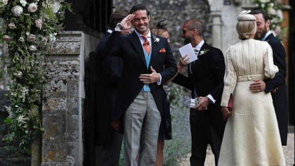 PHOTO: Spencer Matthews, left, gestures as he stands with James Middleton, right, and Donna Air at the entrance of St Mark's Church in Englefield, England, ahead of the wedding of Pippa Middleton and James Matthews, May 20, 2017. (Kirsty Wigglesworth, Pool via AP)