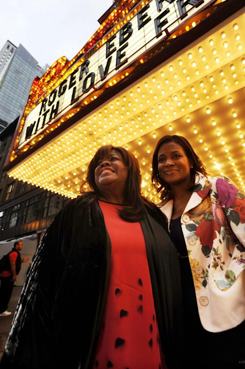 Roger Ebert's wife Chaz Ebert, left, and her daughter Sonia Evans, right, arrive at The Chicago Theater before a memorial for film critic Roger Ebert in Chicago, Thursday, April 11, 2013. The Pulitzer Prize winning critic died last week at the age of 70 after a long battle with cancer. (AP Photo/Paul Beaty)