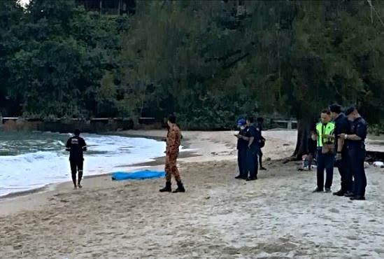 Search and rescue personnel at Teluk Batik beach. Photo: Myra Lamb /YouTube