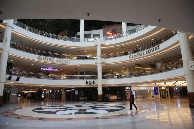 A near-deserted Mid Valley shopping mall in Kuala Lumpur as the movement control order kicks in on March 18, 2020. — Picture by Choo Choy May