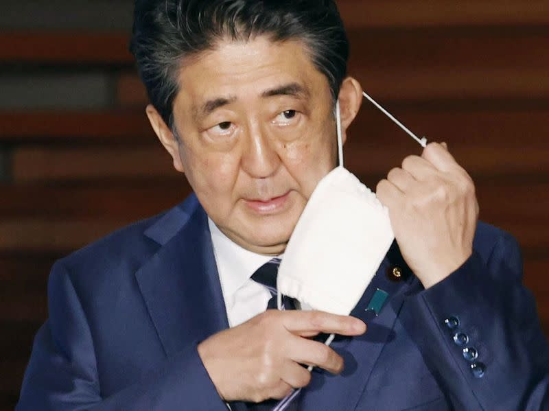 Japan PM Abe's support slides as top prosecutor's resignation bites