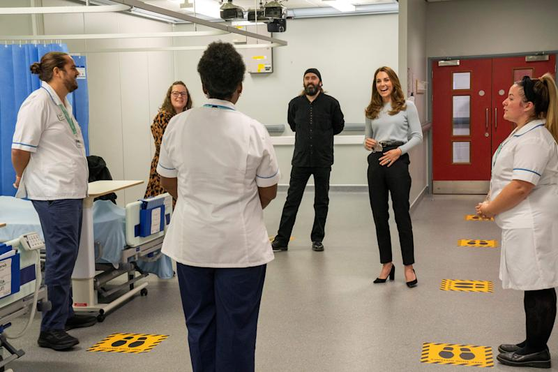 Britain's Catherine, Duchess of Cambridge gestures as she chats with students during her visit to the University of Derby in Derby, central England, on October 6, 2020, where she met students to hear how the novel coronavirus COVID-19 pandemic has impacted university life, and what national measures have been put in place to support student mental health. (Photo by Arthur EDWARDS / various sources / AFP) (Photo by ARTHUR EDWARDS/AFP via Getty Images)