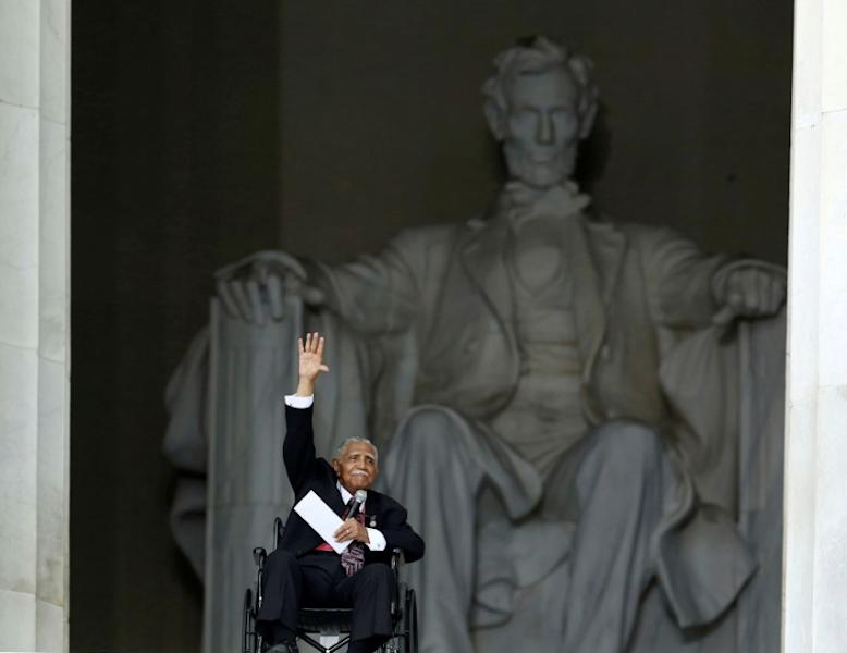 FILE PHOTO: Joseph Lowery waves at the Lincoln Memorial in Washington