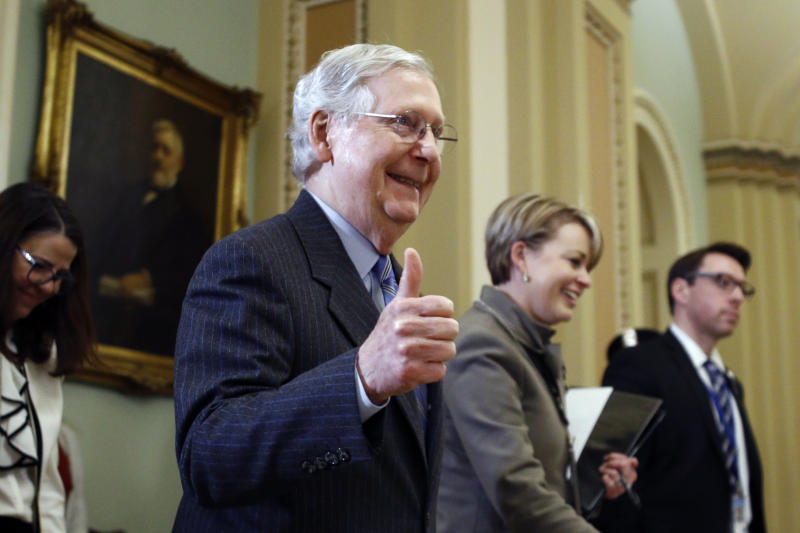 Senate Majority Leader Mitch McConnell, R-Ky., gives a thumbs-up as he leaves the Senate chamber during the impeachment trial of President Donald Trump at the Capitol Friday, Jan. 31, 2020, in Washington. (AP Photo/Steve Helber)