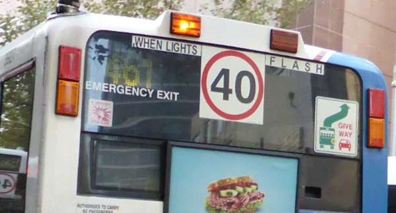 A NSW bus with 40 speed limit sign and flashing lights signals drivers to slow to 40km/h.