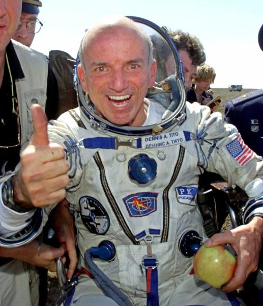FILE - In this Sunday, May 6, 2001 file photo, U.S. multimillionaire Dennis Tito gives a thumbs up shortly after his landing in the Central Asian steppes, 80 kilometers (50 miles) northeast of Arkalyk, Kazakstan. The Russian Soyuz capsule carrying the world's first paying space tourist landed successfully, capping off Tito's multimillion dollar cosmos adventure. (AP Photo/Mikhail Metzel)
