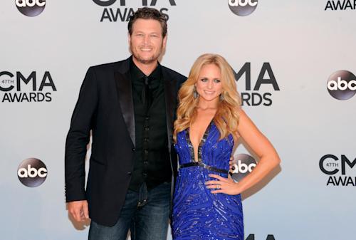 Miranda Lambert , right, and Blake Shelton arrive at the 47th annual CMA Awards at Bridgestone Arena on Wednesday, Nov. 6, 2013, in Nashville, Tenn. (Photo by Evan Agostini/Invision/AP)
