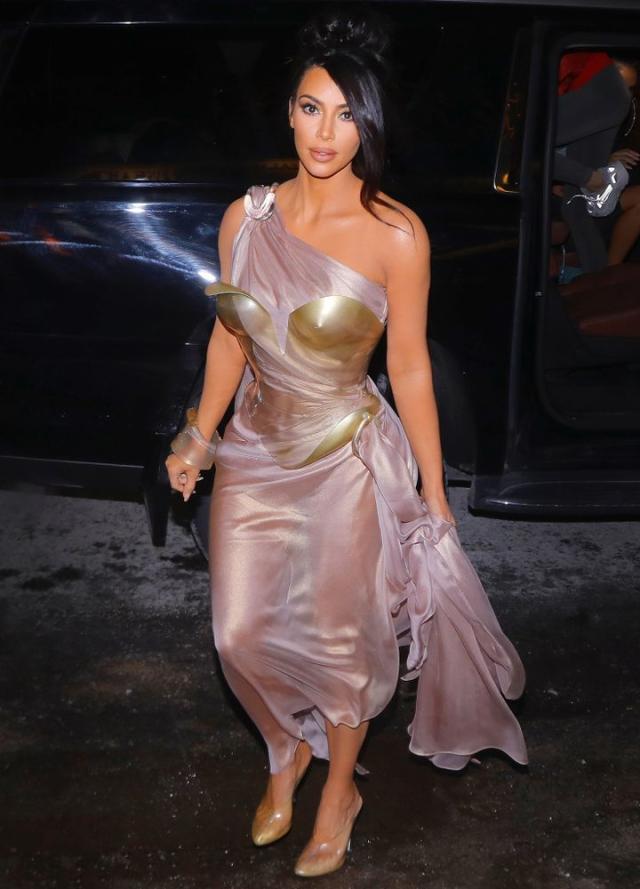 Kim Kardashian wearing a toga-like, sheer gown, designed by Mugler.