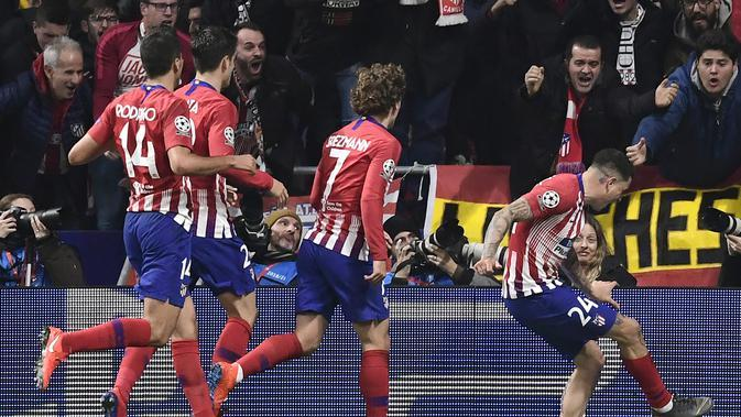 Perayaan gol pemain Atl Madrid usai Jose Gimenez mencetak gol pada leg 1, babak 16 besar Liga Champions yang berlangsung di stadion Wanda Metropolitano, Madrid., Kamis (21/2). Atl Madrid menang 2-0 atas Juventus (Javier Soriano)