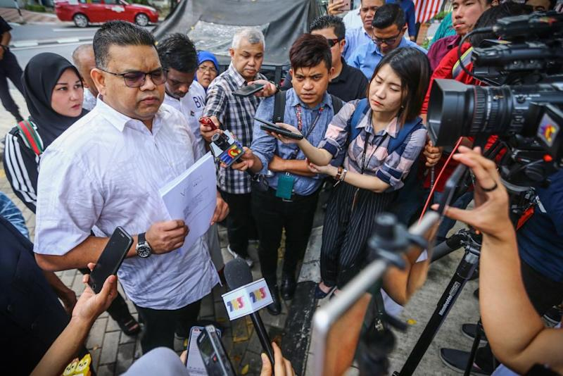Datuk Lokman Noor Adam speaks to reporters outside the Bukit Aman police headquarters September 3, 2019. — Picture by Hari Anggara