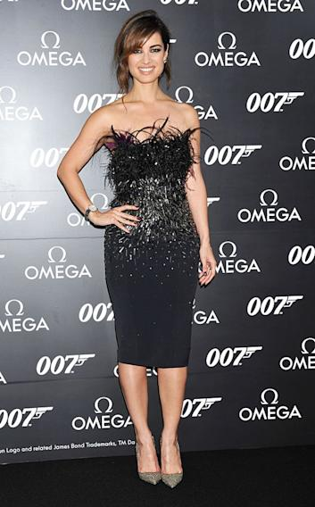 "It's hard to pull off both feathers and extensive beading (that's a lot going on), but Bérénice Marlohe did just that at the Japanese premiere of ""Skyfall."" No wonder she's Bond girl material! The French actress' detailed LBD fit her to a T, while her heels added extra sparkle. Meanwhile, Marlohe's messy updo had a romantic vibe, but it didn't steal the spotlight away from her party frock, which was certainly the main attraction. (11/19/2012)"