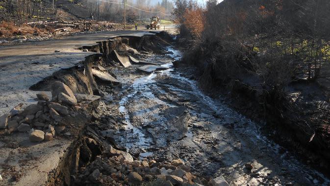 Ilustrasi kerusakan akibat longsor (AFP Photo)