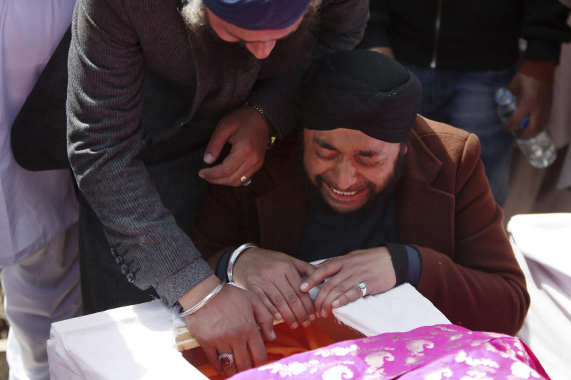 Afghan Sikh men mourn their beloved ones during a funeral procession for those who were killed on Wednesday by a lone Islamic State gunman, rampaged through a Sikh house of worship, in Kabul, Afghanistan, Thursday, March 26, 2020. An explosive device disrupted Thursday's funeral service for 25 members of Afghanistan's Sikh minority community, killed in an attack by the Islamic State group on their house of worship in the heart of the capital. (AP Photo/Tamana Sarwary)