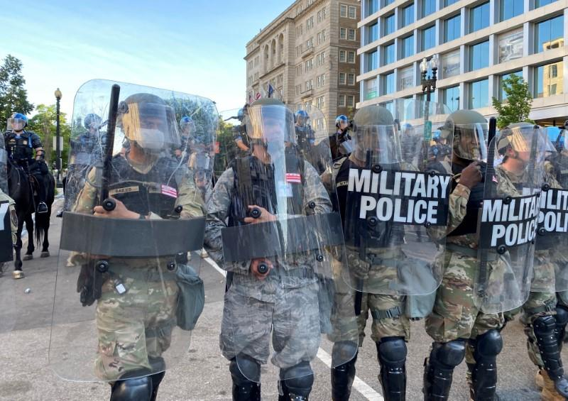 Washington, D.C. national guard military police block street near White House as number of U.S. military forces deployed to streets increases in Washington