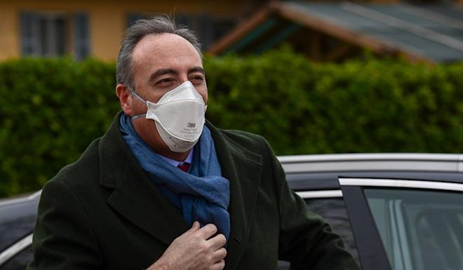 "Health Councillor for the Lombardy region, Giulio Gallera, wearing a FPP2 face mask, outside a sports centre in Milan where an intensive care unit was set up during the coronavirus pandemic: ""Today is perhaps the first positive day we have had in this hard, very tough month."" Photo: AFP"