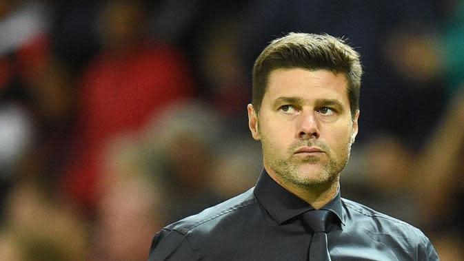 Mauricio Pochettino tercatat baru sekali menang selama menukangi Tottenham Hotspur dalam sembilan laga melawan Liverpool. (AFP/Oli Scarff)