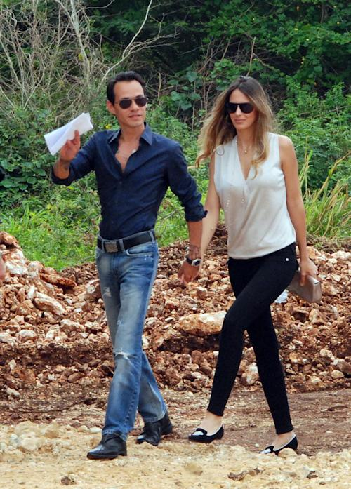 In this image released by the Maestro Cares Foundation, singer Marc Anthony and his girlfriend, model Sharon de Lima, arrive for the groundbreaking ceremony of the new facilities for the Children of Christ orphanage in the eastern city of La Romana, Dominican Republic, Friday, Nov. 23, 2012. The foundation, run by Anthony with music and sports producer Henry Cardenas, plans to build a new residence hall, classrooms and a baseball field for the orphanage founded in 1996 for children who were abused or abandoned or whose parents were unable to care for them. (AP Photo/Maestro Cares Foundation)