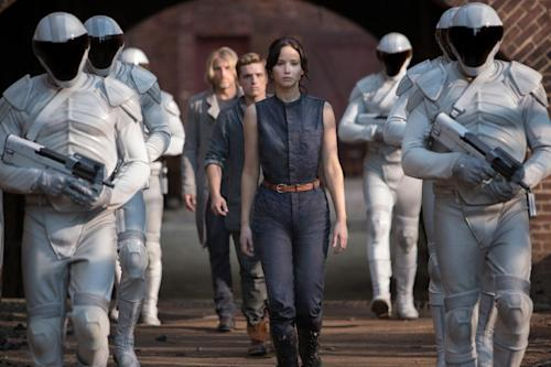 "This image released by Lionsgate shows Jennifer Lawrence as Katniss Everdeen, from foreground to background, Josh Hutcherson as Peeta Mellark and Woody Harrelson as Haymitch Abernathy in a scene from ""The Hunger Games: Catching Fire."" (AP Photo/Lionsgate, Murray Close)"