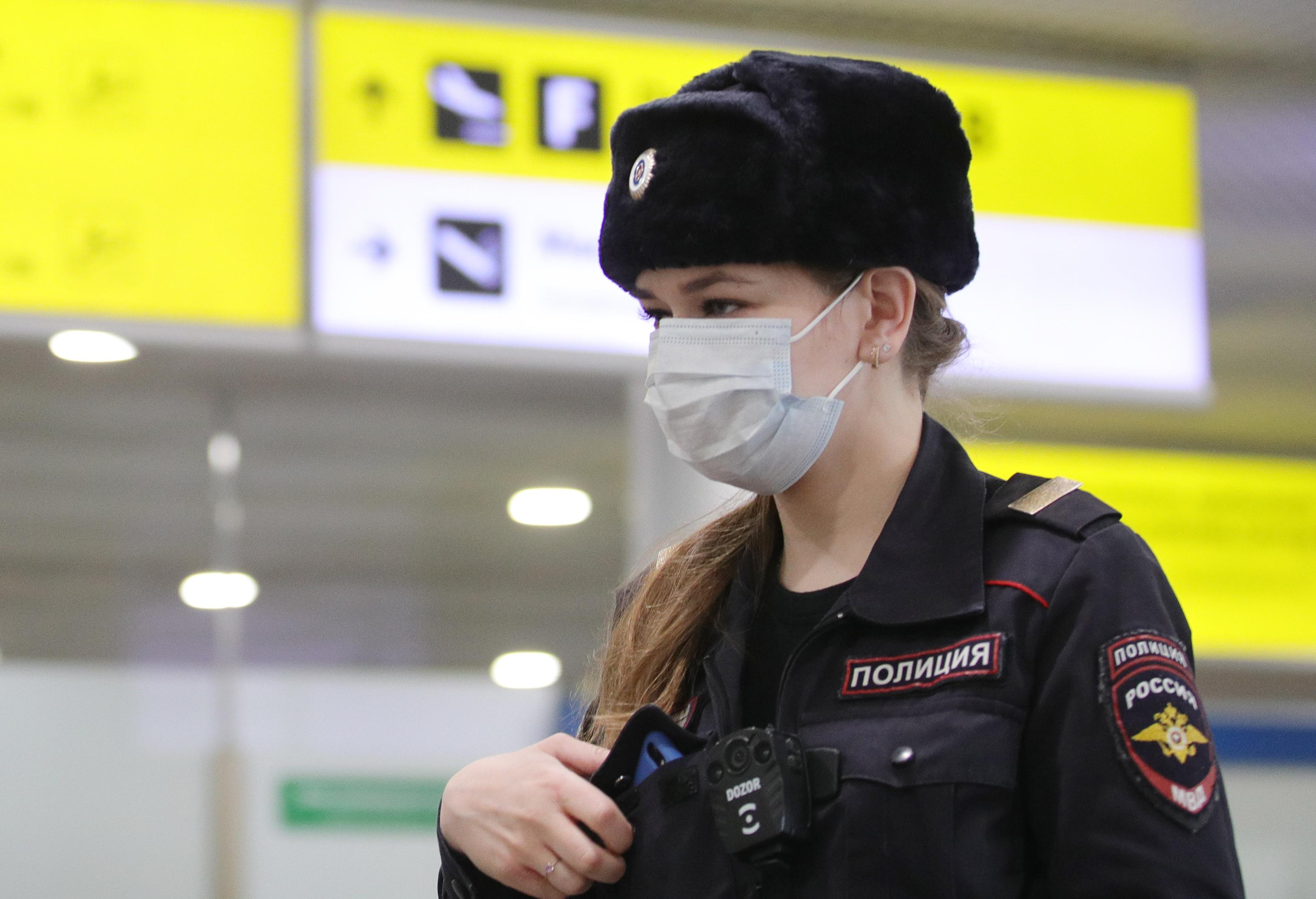MOSCOW REGION, RUSSIA - APRIL 1, 2020: A police officer in a medical mask at Terminal D of Sheremetyevo International Airport where Russian citizens have arrived from New Delhi. The airport shuts down Terminal D from April 1, 2020 due to decrease of passenger flow amid the COVID-19 coronavirus pandemic. All international flights are transferred to Terminal F, internal to Terminal B. Sergei Bobylev/TASS (Photo by Sergei Bobylev\TASS via Getty Images)