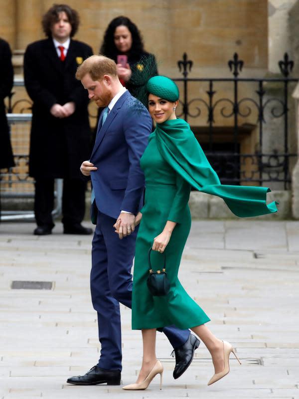 Meghan Markle dan Pangeran Harry saat hadir di Commonwealth Day Service 2020 di Westminster Abbey. (TOLGA AKMEN / AFP)