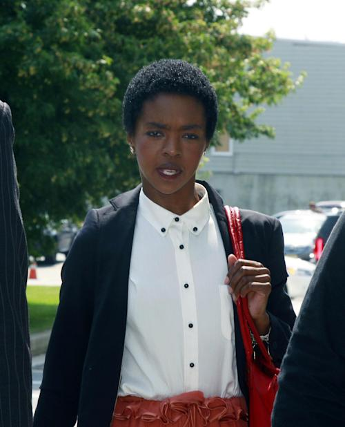 Lauryn Hill arrives at federal court Friday, June, 29, 2012, in Newark, N.J. The eight-time Grammy Award winner and South Orange, N.J., resident was charged this week with willfully failing to file income tax returns with the Internal Revenue Service. Federal prosecutors said she didn't pay taxes on more than $1.5 million earned in 2005, 2006 and 2007 from recording and film royalties. (AP Photo/Mel Evans)