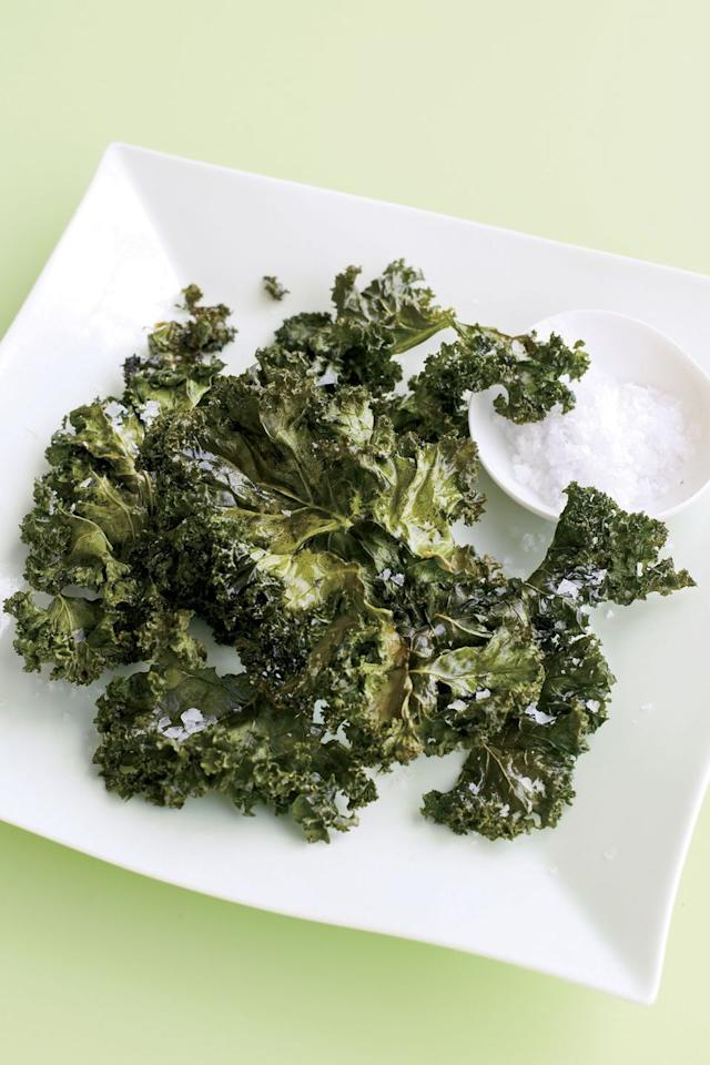 "<p>If you haven't jumped on the kale band wagon, what are you doing? This light and salty ""chips"" will satisfy your salt-cravings at only 15 calories per serving.  </p><p><em><a href=""https://www.goodhousekeeping.com/food-recipes/a7235/kale-chips-ghk0208/"" target=""_blank"">Get the recipe for Kale Chips »</a></em></p><p><strong>RELATED:</strong> <a href=""https://www.goodhousekeeping.com/health/diet-nutrition/a25587450/kale-nutrition/"" target=""_blank"">Kale Is Actually One of the Healthiest Things You Can Eat</a></p>"