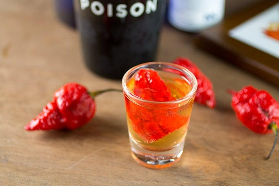 "<p>If spicy is your thing, the <a href=""http://www.chilipeppermadness.com/chili-pepper-recipes/drinks/scorpion-tongue-vodka-shot/"" target=""_blank"" class=""ga-track"" data-ga-category=""Related"" data-ga-label=""http://www.chilipeppermadness.com/chili-pepper-recipes/drinks/scorpion-tongue-vodka-shot/"" data-ga-action=""In-Line Links"">scorpion tongue vodka shot</a> is perfect for you. It combines blood orange vodka, bitters, and a little energy drink with a slice of scorpion pepper for a creepy-looking drink that'll spice up your <a class=""sugar-inline-link ga-track"" title=""Latest photos and news for Halloween"" href=""https://www.popsugar.co.uk/Halloween"" target=""_blank"" data-ga-category=""Related"" data-ga-label=""https://www.popsugar.co.uk/Halloween"" data-ga-action=""&lt;-related-&gt; Links"">Halloween</a> bash.</p>"
