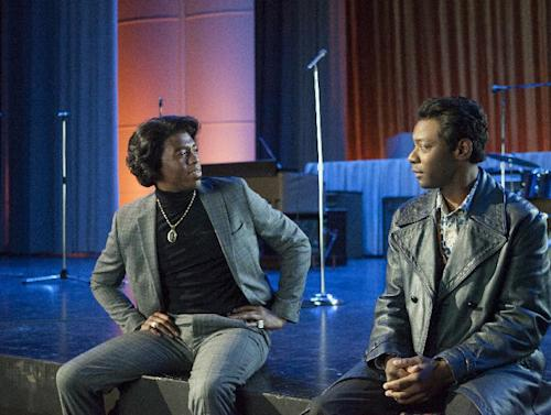 "This image released by Universal Pictures shows Chadwick Boseman, left, and Nelsan Ellis in a scene from ""Get On Up."" (AP Photo/Universal Pictures, D Stevens)"