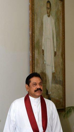 Sri Lankan President Mahinda Rajapakse is pictured in Colombo on November 8. Rights groups see the impeachment of the chief justice as the latest attempt by Rajapakse to tighten his grip on power after crushing Tamil rebels in 2009