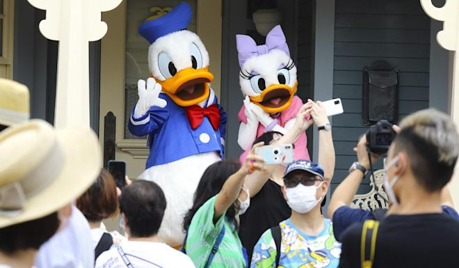 Selfies with popular Disney characters are still allowed, though with social-distancing rules in place. Photo: Dickson Lee