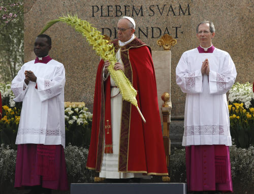 Pope Francis celebrates Palm Sunday Mass, in St. Peter's Square, at the Vatican, Sunday, March 24, 2013. (AP Photo/Andrew Medichini)
