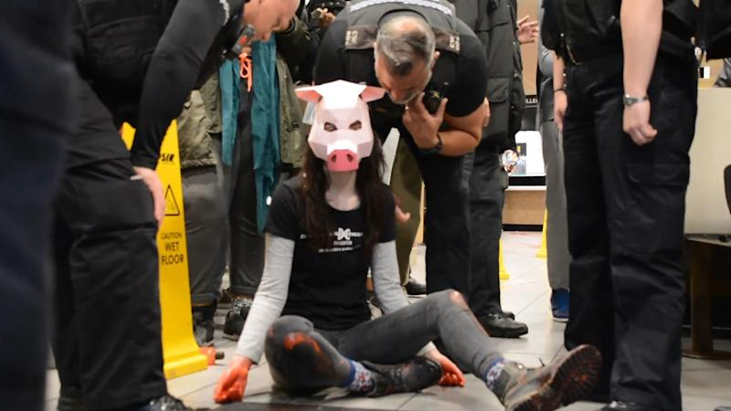 MANDATORY CREDIT REQUIRED - DxeBrighton Undated handout photo issued by DxeBrighton of Vegan activist Dylan Roffey wearing a pig mask during a protest in a McDonald's on May 17 where red 'blood' was thrown around. Roffey, 24, is standing trial at Brighton Magistrates Court charged with criminal damage and resisting a police officer.. Issue date: Thursday September 12, 2019. See PA story COURTS Vegan. Photo credit should read: DxeBrighton/PA Wire NOTE TO EDITORS: This handout photo may only be used in for editorial reporting purposes for the contemporaneous illustration of events, things or the people in the image or facts mentioned in the caption. Reuse of the picture may require further permission from the copyright holder. Photo. Picture date: Thursday September 12, 2019. See PA story COURTS Vegan. Photo credit should read: DxeBrighton/PA Wire Undated handout photo issued by DxeBrighton of Dylan Roffey, 24 outside XXXX Court where she is on trial for criminal damage. PA Photo. Issue date: Thursday September 12, 2019. See PA story COURTS Vegan. Photo credit should read: DxeBrighton/PA Wire NOTE TO EDITORS: This handout photo may only be used in for editorial reporting purposes for the contemporaneous illustration of events, things or the people in the image or facts mentioned in the caption. Reuse of the picture may require further permission from the copyright holder. Photo. Picture date: Thursday September 12, 2019. See PA story COURTS Vegan. Photo credit should read: DxeBrighton/PA Wire