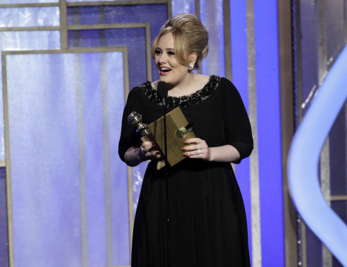 "This image released by NBC shows singer Adele, winner of the award for best original song for ""Skyfall"" on stage during the 70th Annual Golden Globe Awards at the Beverly Hilton Hotel on Jan. 13, 2013, in Beverly Hills, Calif. (AP Photo/NBC, Paul Drinkwater)"