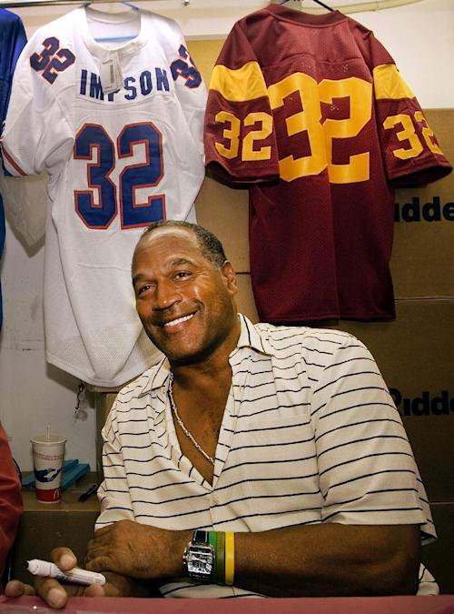 "FILE - In this Sept. 30, 2005 file photo, O.J. Simpson signs autographs during an event hosted by the ""NecroComicon'' horror convention in Northridge, Calif. The return of O.J. Simpson to a Las Vegas courtroom next Monday, May, 13, will remind Americans of a tragedy that became a national obsession and in the process changed the country's attitude toward the justice system, the media and celebrity. The return of O.J. Simpson to a Las Vegas courtroom next Monday, May, 13, will remind Americans of a tragedy that became a national obsession and in the process changed the country's attitude toward the justice system, the media and celebrity. (AP Photo/Damian Dovarganes, File)"