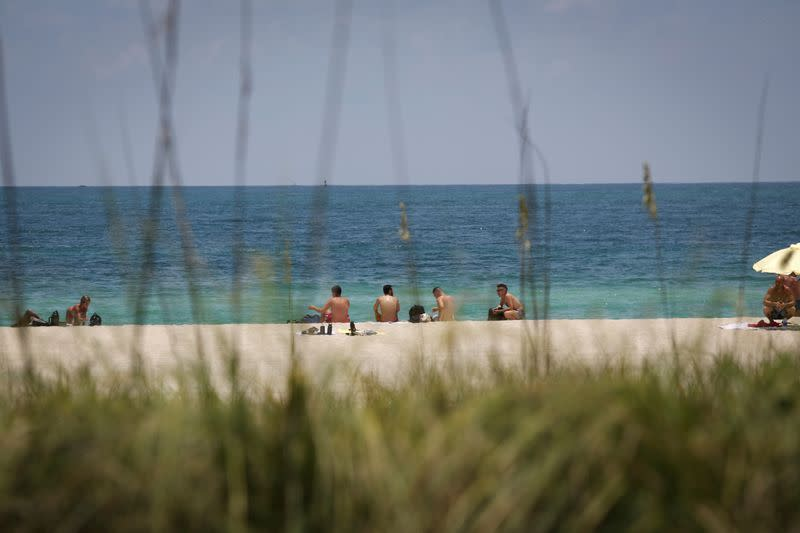 FILE PHOTO: Beaches reopen with restrictions to limit the spread of the coronavirus disease in Miami Beach