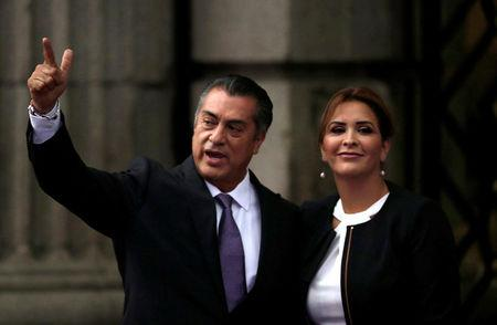 Independent presidential candidate Jaime Rodriguez and his wife Adeline Davalos gesture after arriving at Palacio de Mineria for the first presidential debate in Mexico City, Mexico April 22, 2018. REUTERS/Henry Romero