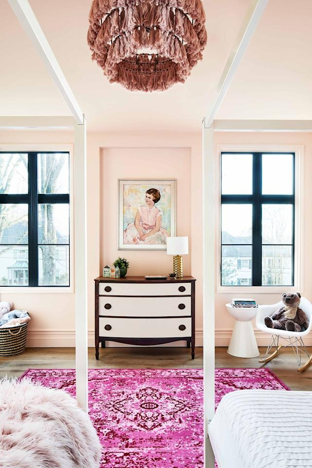 """<p>""""This color reminds me of summertime happiness,"""" says Georgia-based interior designer <a href=""""https://elainegriffin.com/"""" target=""""_blank"""">Elaine Griffin</a>. """"It's like painting your walls with peach ice cream, or bringing the warmth of a morning sunset into your home."""" This <a href=""""https://www.elledecor.com/design-decorate/house-interiors/a29766125/carmel-greer-washington-dc-house-tour/"""" target=""""_blank"""">sweet Washington, D.C., bedroom</a> features varying hues of pink. </p>"""
