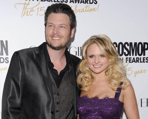 "FILE - This March 5, 2012 file photo shows country singers Blake Shelton, left, and his wife, Miranda Lambert at Cosmopolitan Magazine's ""Fun Fearless Males and Females of 2012"" awards in New York. Shelton's ""Mine Would Be You"" and Miranda Lambert's ""Mama's Broken Heart"" are both nominated for a Grammy award for best country solo performance. (AP Photo/Evan Agostini, file)"