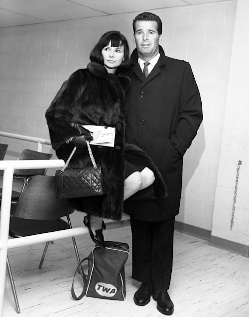 """FILE - Actor James Garner, right, and his wife Lois are shown in the Trans World Flight Center prior to boarding a TWA Jetliner enroute to London in this Feb. 21, 1964 file photo taken in New York. Actor James Garner, wisecracking star of TV's """"Maverick"""" who went on to a long career on both small and big screen, died Saturday July 19, 2014 according to Los angeles police. He was 86. (AP Photo/MGM, File) NO SALES"""