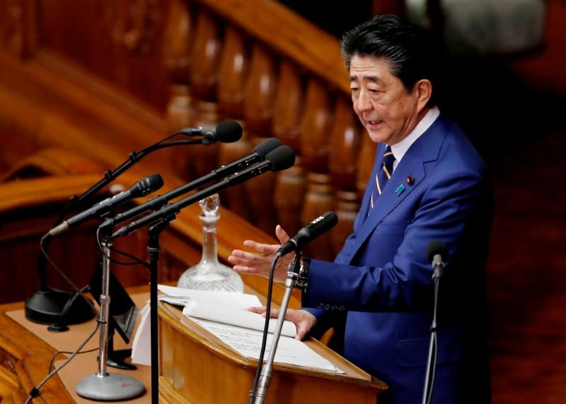 Japanese Prime Minister Shinzo Abe gives a policy speech at the start of the regular session of parliament in Tokyo