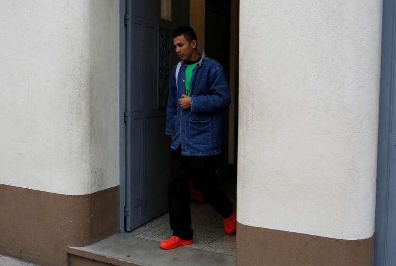 Erwin Ardon, the first Honduran migrant sent back home under new restrictions pushed by U.S. President Donald Trump, leaves a migrant shelter, in Guatemala City