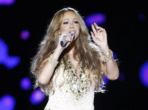 "FILE - This May 26, 2012 file photo shows U.S. Singer Mariah Carey performing on stage during a concert at the Mawazine Festival in Rabat, Morocco. A person familiar with the singing competition series ""American Idol"" negotiations say Carey is being pursued to join the judging panel of the Fox talent competition. The source requested anonymity because of the private nature of negotiations. (AP Photo/Abdeljalil Bounhar, file)"