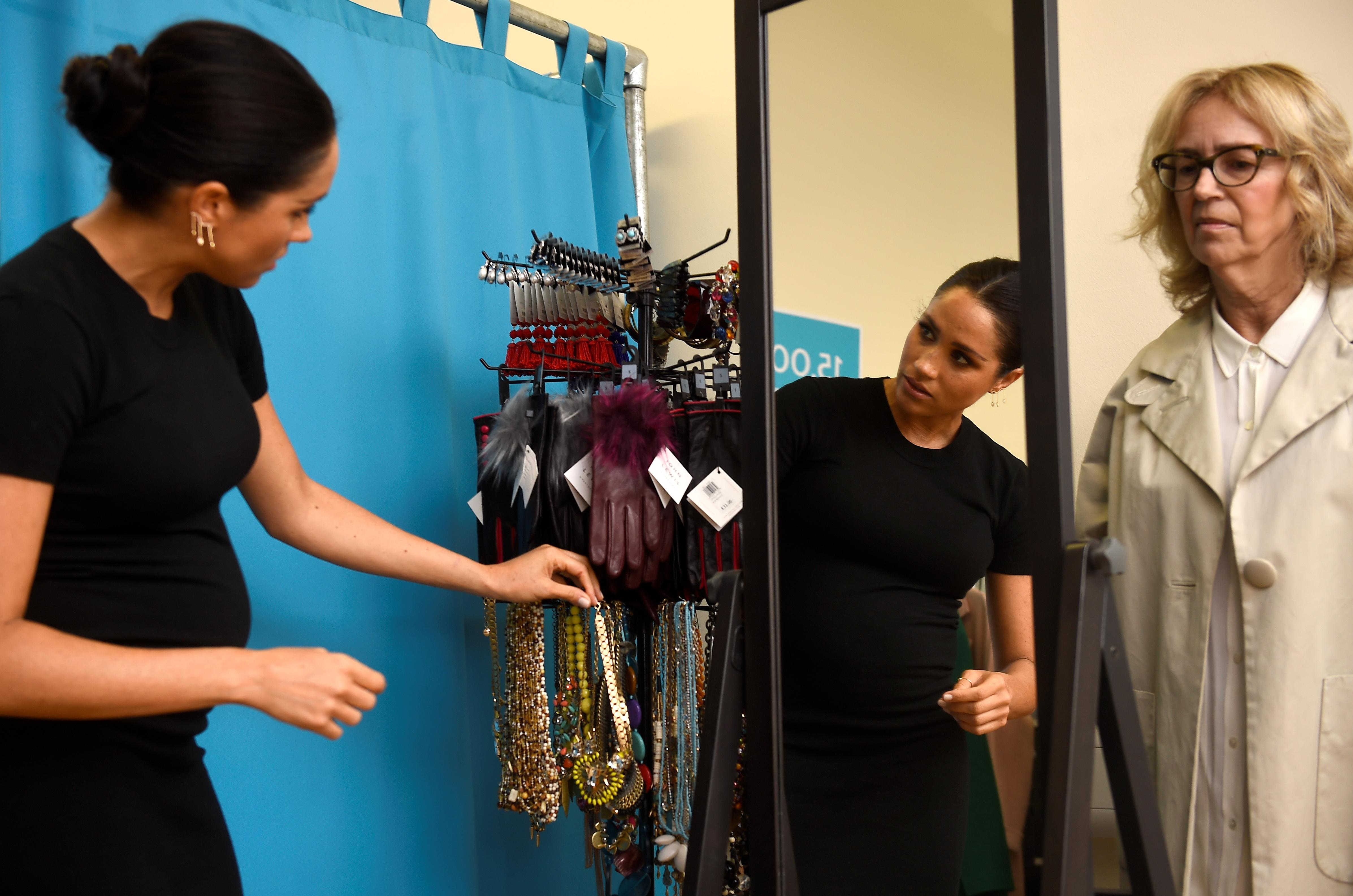 Meghan, the Duchess of Sussex, picks out a necklace with Lady Juliet Hughes-Hallett during her visit at Smart Works charity in West London, Britain, January 10, 2019. REUTERS/Clodagh Kilcoyne/Pool